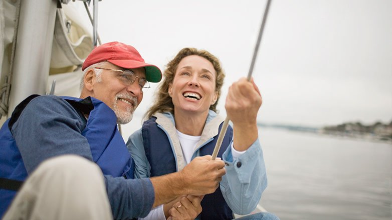 Retired couple on sailboat enjoying their retirement.