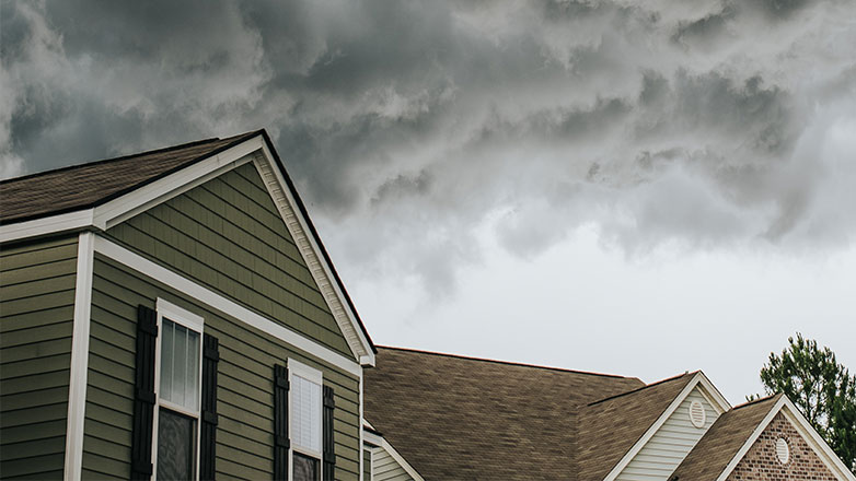 Storm clouds over a block of homes.