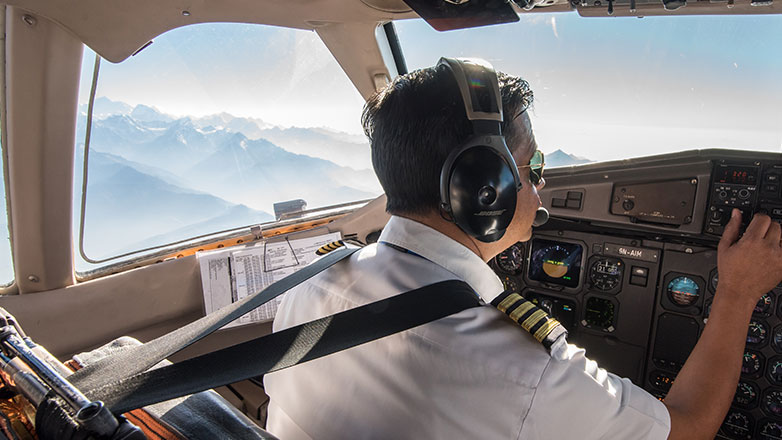 Airline pilot safely flying an airplane.