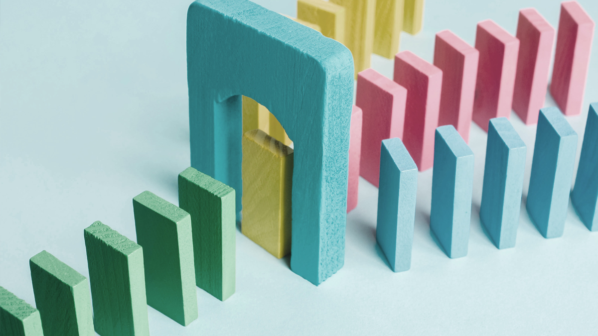 colored dominoes consolidating under an arch