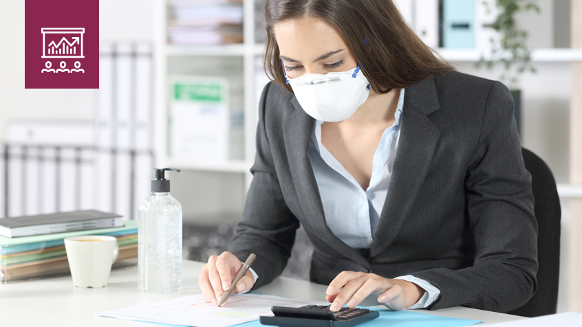 business woman wearing a mask and using a calculator