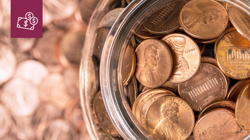 close up of coins in a glass jar