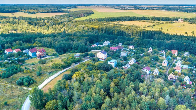 aerial view of small town on countryside with trees