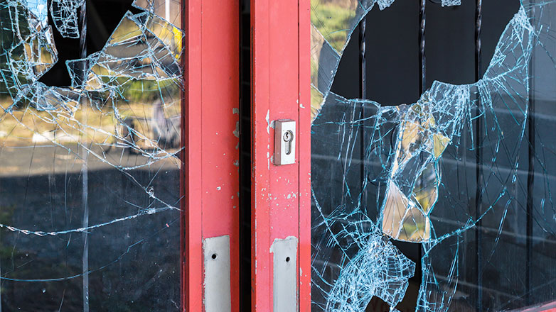 business front doors with broken windows