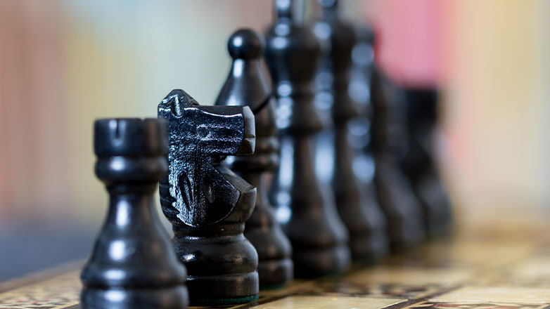 close up chess pieces with blurred background