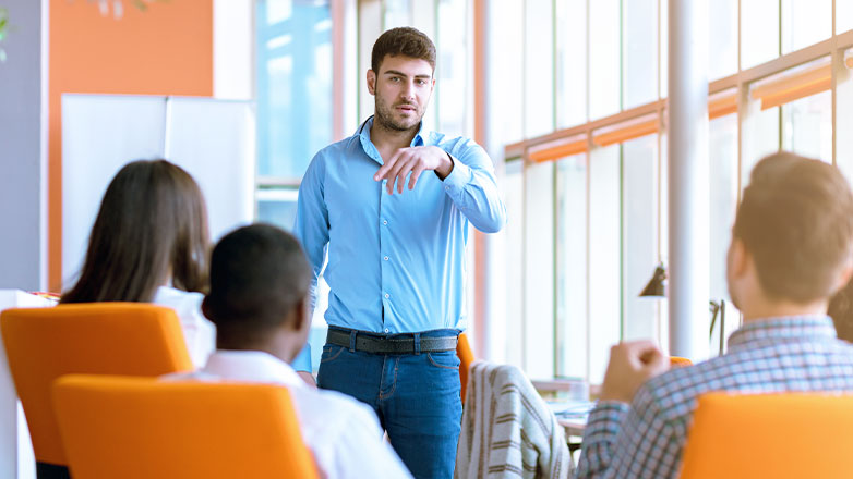 man giving presentation to employees in meeting