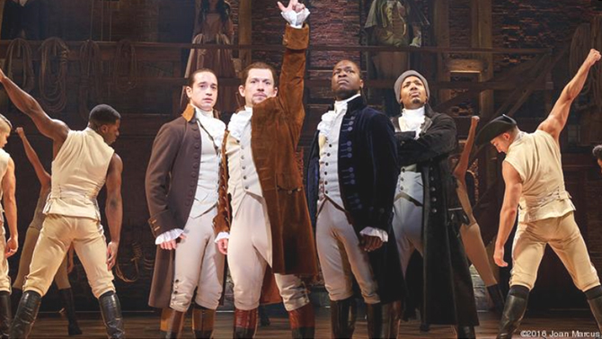 Actors in the famous Broadway show Hamilton pose.